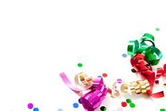 Multi colored confetti and streamers on white Stock Photos