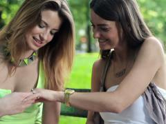 Happy excited woman showing her engagement ring to her friend NTSC Stock Footage