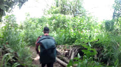Hiker Follows Guide Through Jungle Stock Footage