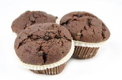 Group of chocolate muffins isolated - stock photo