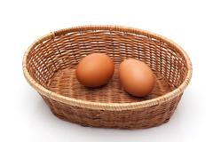 two eggs in wicker basket - stock photo