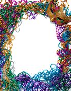 Border made of mardi gras bead and mask on white Stock Photos