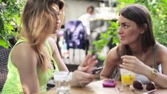 Young pretty girlfriends with smartphone in cafe HD - stock footage
