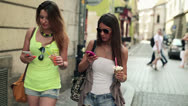 Stock Video Footage of Attractive girlfriends with smartphone walking in the city HD