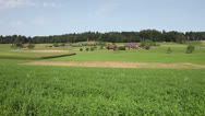 Stock Video Footage of Green Swiss Farmland (HD Pan)