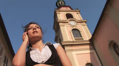 Talkative girl in old town Stock Footage