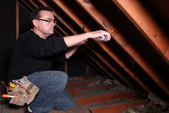 Contractor Measures Rafters Attic NTSC Stock Footage