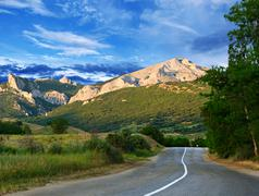 road, mountains and blue sky - stock photo