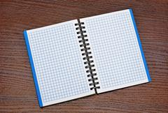 notepad on a wooden table - stock photo