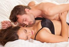 Young man and woman in bed. couple. Stock Photos