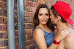 shot of a passionate young people in love outdoor - stock photo