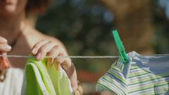 young mother baby clothes hanging out to dry - stock footage