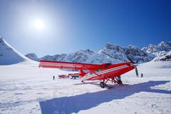 red plane on glacier - stock photo