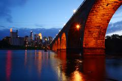 minneapolis downtown and historic bridge - stock photo