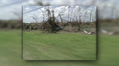 Disaster, HD drive by of damaged business, trees, Hurricane Andrew damage Stock Footage