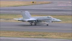 F18 Hornet jet on airport runway Stock Footage