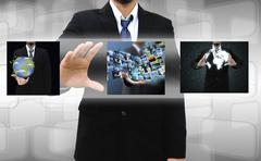businessman holding reaching images streaming in hands .financial and technol - stock photo