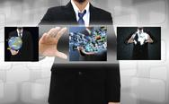 Stock Photo of businessman holding reaching images streaming in hands .financial and technol