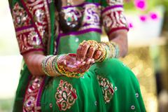 Stock Photo of woman wearing traditional indian henna and robes