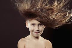 Caucasian girl with hair blowing in wind Stock Photos