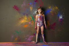 Caucasian girl playing with paint Stock Photos