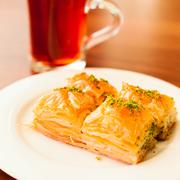 Oriental sweets baklava served with cup of tea Stock Photos