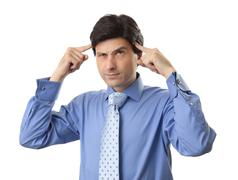 handsome businessman doubting isolated over white background - stock photo