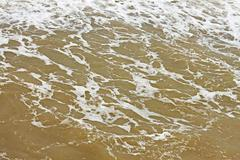 foamy seawater surface after the storm - stock photo