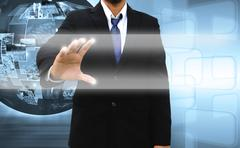 Businessman pushing a touch screen interface Stock Photos