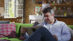 Mature loving couple relaxing at home in their chic loft apartment Stock Footage