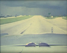 Super 8 USA driving a 1984 Mercury on the Florida highway Stock Footage