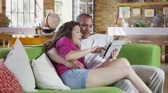 Sexy young couple relaxing at home together in their chic loft apartment Stock Footage