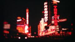 Las Vegas neon on casinos at night, 102 vintage film home movie Stock Footage