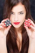 Woman holding chips for gambling Stock Photos
