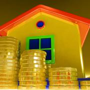 Stock Illustration of coins around house showing paying rent