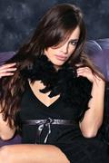 Pretty woman on dark background Stock Photos
