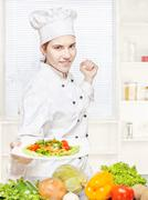 chef offering vegetarian meal - stock photo
