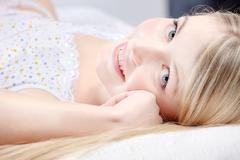 cute blond girl on pillow - stock photo