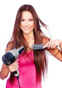 Woman blow dryer and comb Stock Photos