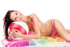 girl in bikini with ball on air mattress - stock photo