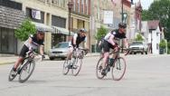 Stock Video Footage of Bikes Making Corner in Town