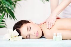 Woman on shoulder massage Stock Photos