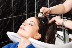 hairdresser rinse customers hair - stock photo