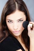 girl's powder brush - stock photo