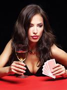 Pretty woman gambling on red table Stock Photos