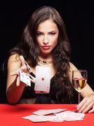 Woman gambling on red table Stock Photos