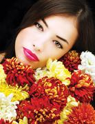 Woman face with flowers Stock Photos