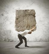 stress of a businessman with a big rock - stock illustration
