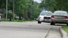 Police Cars on Road - stock footage