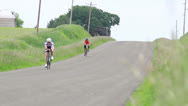 Stock Video Footage of Two Bikes on Hill